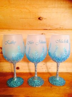 Decorative Bottles : Frosted and glitter wine glasses with names or monogram Glitter Wine Glasses, Diy Wine Glasses, Decorated Wine Glasses, Hand Painted Wine Glasses, Christmas Glitter Glasses, Wedding Wine Glasses, Custom Wine Glasses, Christmas Wine, Champagne Glasses