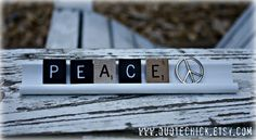 Scrabble Tile Rack Sign - Peace. $22.00, via Etsy.  This turned out to be darling.  Has all sorts of other stuff like love you, etc.  Unique gift