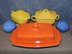 Homer Laughlin Riviera Red Butter Dish, Yellow Creamer and Sugar Bowl and Mauve Salt Shakers