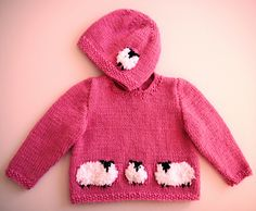 Colourful jumper with fluffy sheep and a hat to match.