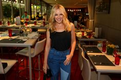 Kylie Minogue Photos Photos - In this handout photo provided by Singapore GP, Kylie Minogue poses in the Formula One Paddock Club on day two of the Singapore Formula One Grand Prix at Marina Bay Street Circuit on September 17, 2016 in Singapore. - Singapore Grand Prix - Live Performances
