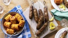 These Pakistani lamb kebabs take no time at all to make. Simply blend everything together, shape around a skewer, chill and then grill for 20 minutes, until charred. The kebabs and the corn could also be cooked on a BBQ.   You will need eight metal skewers.