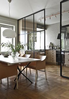 Glass doors between kitchen and dining