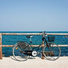 Trani, Italy. At day's end, locals in Trani hook their bikes on the railings and go for a swim. | Coastalliving.com