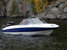 Our 160 Bayliner boat by the rocks at Bon Echo