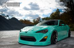 Scion FR S in Mint Green and slammed on Rotiform SNAs
