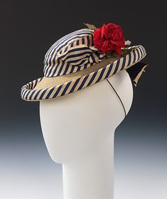 Elsa Schiaparelli (Italian, 1890–1973). Hat, summer 1940. The Metropolitan Museum of Art, New York. Brooklyn Museum Costume Collection at The Metropolitan Museum of Art, Gift of the Brooklyn Museum, 2009; Gift of Millicent Huttleston Rogers, 1951 (2009.300.1837) | Red, white and blue are colors often used in nautical flags, and Schiaparelli has playfully interpreted those colors in this sailor-inspired doll hat from her summer 1940 collection.