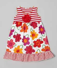 This pretty piece's vibrant hues and comfy construction will make the urge to twirl completely irresistible. Its fanciful floral skirt and charming appliqué play sweetly with stripes and a darling ruffle while crinkly trim dances along the edges.