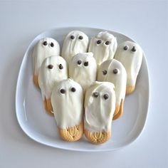 Ghost Cookies  1. Oblong Cookie 2. White Icing 3. Mini Chocolate Chips