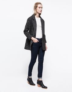 Casual. Skinny jeans, basic tee, coat, and ankle boots.