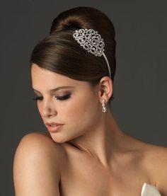 Sleek, mod bun with a lovely headband in lieu of a fascinator or veil