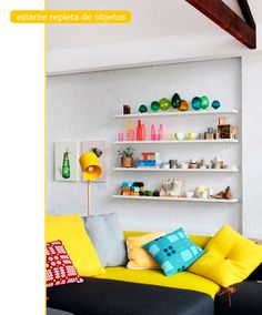 Blues, greens, golds, oranges, pinks and purples  - yellow pillows