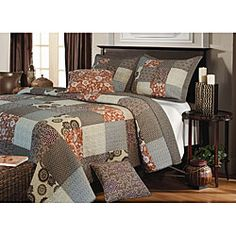 @Overstock - Stylized floral medallions combine with geometric prints featuring crisp, fine lines in the Stella quilted bedding set. Patchwork construction in shades of taupe, sienna, burgundy, aloe and grey reverse to a coordinating geometric print. http://www.overstock.com/Bedding-Bath/Stella-Quilt-Set/6756839/product.html?CID=214117 $59.99