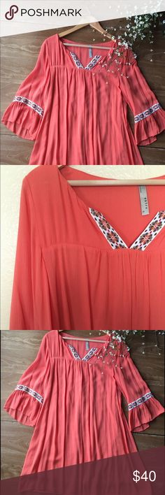 Women's dress or tunic This is a beautiful bright coral colored dress or tunic! I paired it with white leggings and was set. Size small but runs big and is flowy. Can fit up to a large I would say. (Depends how you want it to fit) Length is 35 inches from shoulder to bottom. Only worn once. Please take this out of my closet! entro Dresses Asymmetrical