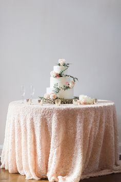 Cake table with white and floral cake by Maxie Bs at Raleigh Wedding | Southern Bride and Groom | Planned expertly by Sally Oakley Wedding & Events. @sallyoakley | Missy Loves Jerry Photography @missylovesjerry