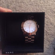SALE brand new Marc Jacobs rose gold watch nwt Beautiful rose gold watch. White face with name around the face and in rose gold. Comes with box and still has tag. Very pretty Marc Jacobs Accessories Watches