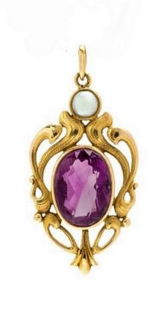 An Art Nouveau Yellow Gold, Amethyst, and Pearl Pendant, consisting of an open scrolling wirework gold setting with hammered detail, containing an oval mixed cut amethyst.