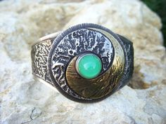 Sterling silver, reticulated silver, and reticulated brass, yin/yang cuff bracelet with bullet cut chrysoprase, cabachon.     This is a very impressiv