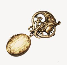 For your consideration is this beautiful pendant brooch.It consist of a pressed gold tone metal in a beautiful art nouveau style of a women