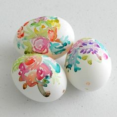 Paint flowers on blown eggs with watercolor paints to create pretty, colorful Easter decor.