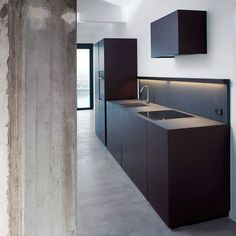 Custom made kitchen in jet black granite by Holgaard Architects.