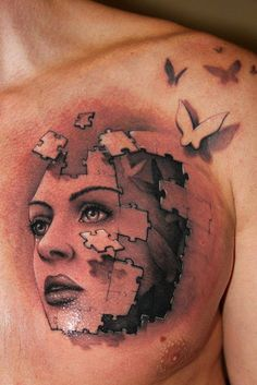 Puzzle lady face tattoo on chest.. Click the pic for more tattoos