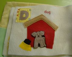 "D is for Dog quiet book page, put dog in kennel (on string). Bowl and bone for ""feeding"""