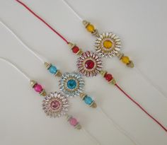 Simple and elegant. Handmade Rakhi Designs, Handmade Design, Quilling Flowers, Quilling Art, Quilling Rakhi, Rakhi Bracelet, Diy Jewelry, Beaded Jewelry, Rakhi Making