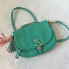MIX NO. 6.❤️❤️. New and so cute! Mix no 6 crossbody bag.  New and so cute.  The perfect size!  Great color.   Green with orange tassel and gold chain/accents.  9 x 6.   Opens up with extra long pocket for storage as well.  Trendy trendy!! Mix no 6 Bags Crossbody Bags