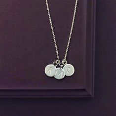 Custom initial necklace with three charms in recycled sterling silver