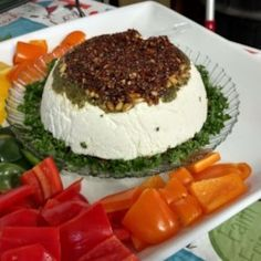 A delectable layered dip for any special occasion made with feta and cream cheese, pesto, pine nuts and sun-dried tomatoes. Looks beautiful on the table, tastes heavenly on your tongue!