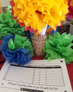 Fiesta theme:Invitations for the teacher's sneak peak... Mason Jars, beans, pipe cleaners and tissue- super cute delivery for the faculty prior to the start of the Fiesta themed book fair.