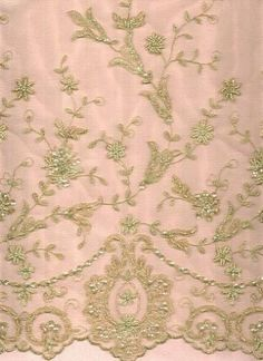 Soft english tulle border pattern. Micro sequins, bugle beads and pearls accent gold metalic embroidery.