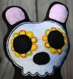 My friend hand sews the most adorable things! visit her shop!  Colorful sugar skull bear embroidered plush by SnailAndCicada