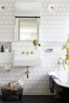 Say Hello To The New Bathroom Tile Trend  #refinery29  http://www.refinery29.uk/bathroom-tiles-style#slide-2  The tiles may be square, but the arrangement in this Antipodean bathroom follow the same brick overlap as their rectangular metro siblings. Grey grout and luxe brass fittings put a polish on the finished look. It's amazing what you can do with a plain white tile....