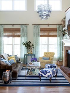 Again, mixing patterns and colors...the striped rug gives it a nautical feel