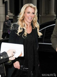 Singer Britney Spears is all smiles as she visits Capital FM Radio in London, England on October 14, 2013.