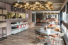 A complete transformation of the existing tapas to create a fast, casual, counter-based chicken and burger restaurant – a place to grab a quick bite between shows. Feature oversized lighting, reclaimed timbers, industrial furniture and corrugated metals blend to give autilitarianfeel to the space.