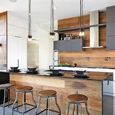 White wood kitchen backsplash a modern space with an industrial feel and warm colored wood on . Kitchen Designs Layout, Kitchen Remodel, Modern Kitchen, Kitchen Decor Modern, New Kitchen, Wood Kitchen Backsplash, Home Kitchens, Kitchen Style, Kitchen Design