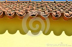 (C) Celia Ascenso - Ceramic Tiles And Shade On Yellow House Wall