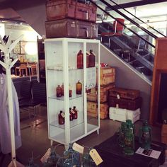 One of our Best of the Past- Industrial Vintage restored medical cabinets from the 1960s and some decorative items like old soda bottles, apothecary bottles and vintage luggage. Picture taken @Home Stock, Limited Editions in Haarlem (picture: Lisa Bernson)