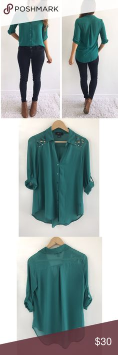 "Deep Green Button Down Blouse Deep Green Button Down Blouse! Excellent condition. Super comfortable and flowy. Buttons down the front. Sheer fabric, 100% polyester. Gem stud detailing on shoulders. Wear with skinny jeans. Chest-39"" front length-25"" back length-28.5"" size small. BCX Tops Blouses"