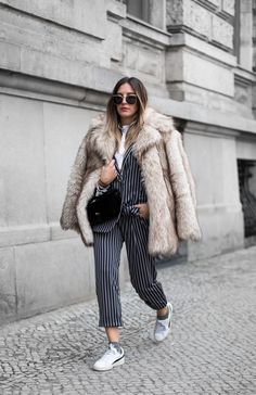 MAX&Co. Sandra Ebert has her boss lady walk down pat, in our sharp pinstripe pantsuit