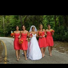 Love the bouquets! not the color of the dresses though.. the bride's dress is pretty but I want more poof!!