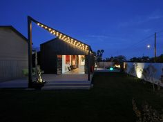 Night time view of the back yard and patio of the modern-historic
