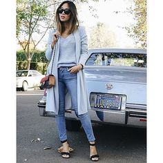 A powder blue cardigan and knit sweater