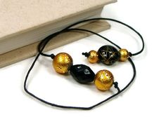 Hey, I found this really awesome Etsy listing at https://www.etsy.com/listing/203598660/book-thong-beaded-bookmark-black-gold