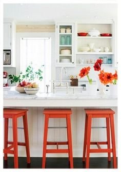 Happy white kitchen with pops of blue & tangerine