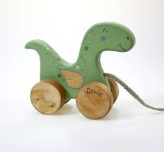 """Wooden Dinosaur Toy, Little Dragon Toy is one of our pull toys for toddlers made of natural materials. These are natural wood toys safe and beautiful friends to your child. Most beautiful dino toy ! ***DIMENTIONS*** Height 6 4/5"""" (17 cm), length 5 2/5"""" (13,5 cm) ***ABOUT FRIENDLY"""