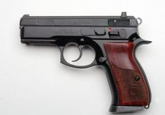 """There is something really nice about a black gun and wood grips.  CZ 75 COMPACT CUSTOM 14+1 9MM 3.8"""" Night Sights $932.00 SHIPS FREE, but for the standard gun it is about $450."""
